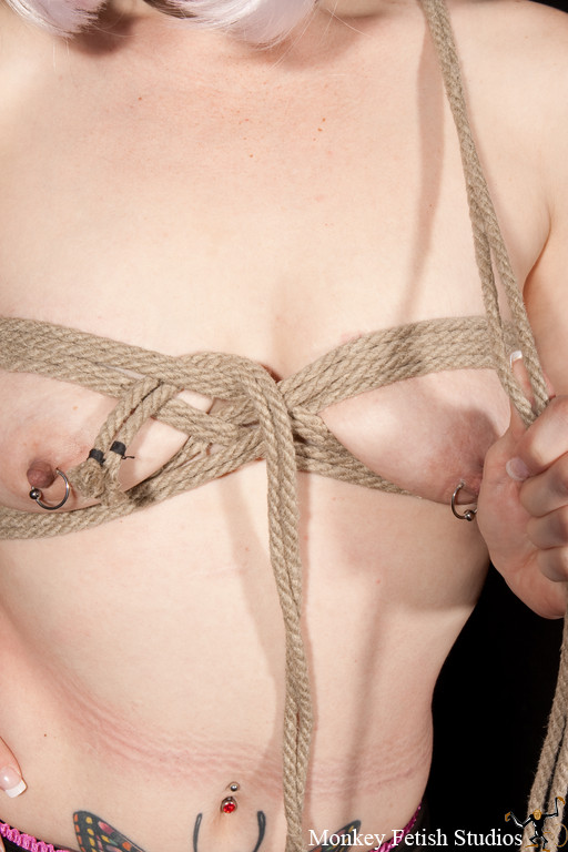 Step 10 - Feed the rope under the top band on the opposing breast.