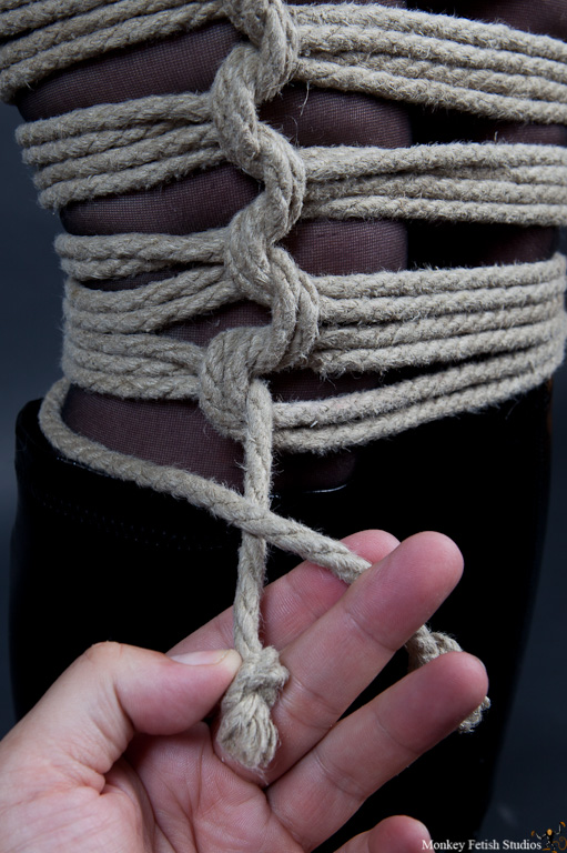 Step 8 - Take the other running end that did not go through the bight and start a square knot.