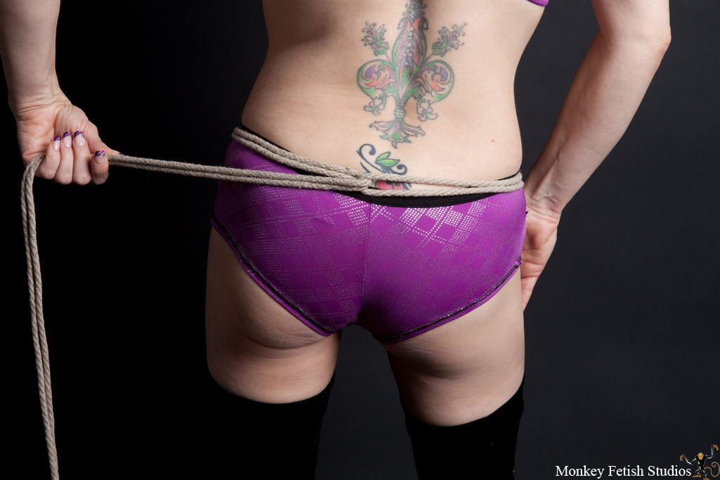 Step 1 - As with most of my bondage, I start with a lark's head.  Starting around the hips, the rope should be placed just above the curve of the hips but below the waist.