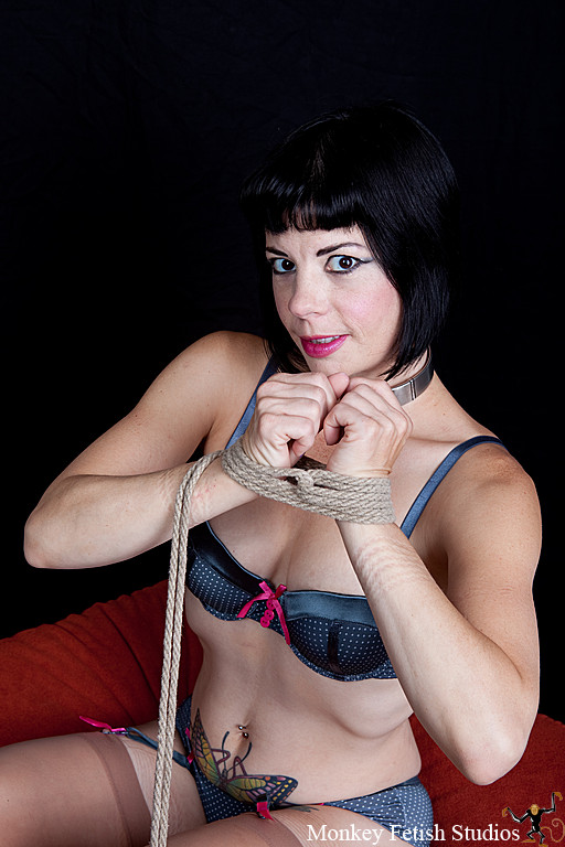 Step 2- Wrap around the wrists several times as with a standard two column tie.